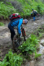 Mountain biker and mud terrain Stock Photo