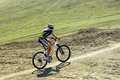 Mountain biker racing Royalty Free Stock Photography