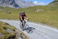 Mountain biker riding though swiss mountain area graubunden switzerland august unidentified taking part in the yearly held multi Royalty Free Stock Photo