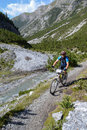 Mountain biker riding though swiss mountain area graubunden switzerland august unidentified taking part in the yearly held multi Stock Image
