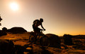 Mountain biker silhouette in sunrise Stock Image