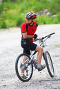 Mountain biker waits Royalty Free Stock Photo