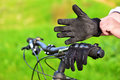 Mountain biker wears old gloves Stock Photo