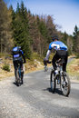 Mountain bikers going uphill Royalty Free Stock Photo