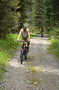 Mountain bikers on old rural road Stock Photo