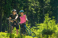 Mountain bikers resting in forest standing and sunny nature Stock Photos