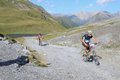 Mountain bikers riding though swiss mountain area graubunden switzerland august unidentified taking part in the yearly held multi Stock Images