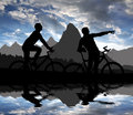 Mountain bikers silhouette sunset Royalty Free Stock Photo