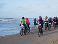 Mountain bikers taking part in the beach race egmond pier egmond netherlands january unidentified contestants of annual bike Stock Photography