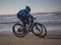 Mountain bikers taking part in the beach race egmond pier egmond netherlands january unidentified contestants of annual bike Royalty Free Stock Photo