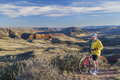 Mountain biking in colorado senior male rugged terrain with cliffs and canyon of red open space northern near fort Stock Photography