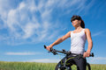Mountain biking happy sportive girl relax in meadows sunny countryside Royalty Free Stock Photo