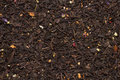 Mountain black tea leaves with flowers and fruits texture Royalty Free Stock Photo