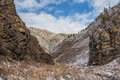 Mountain cliff canyon first snow autumn the path between the mountains and rocks leading to the gorge everything is covered with Stock Photography