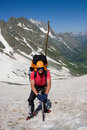 Mountain climber with ice-axe Stock Images