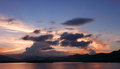 Mountain, cloudscape, dramatic sky, ocean at sunset Royalty Free Stock Photo