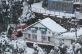 Mountain cottage covered with snow in dalhousie himachal pradesh Royalty Free Stock Photo