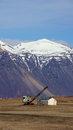 Mountain and crane near Hofn in east fjords in Iceland Royalty Free Stock Photo