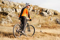Mountain cyclist riding single track in valley Royalty Free Stock Photo