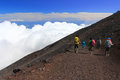 Mountain Fuji climbing and sea of clouds. Royalty Free Stock Photo