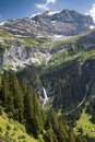Mountain with the glacier cap and huge waterfall near the Klausen pass Royalty Free Stock Images