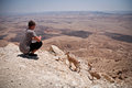 Mountain goats and teenager in the negev desert israel Stock Photo