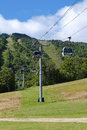 Mountain gondola provides scenic transportation to the top of green in summer Stock Images