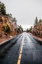 Mountain highway in rain bad weather blacktop road heading up a pass during wet road blacktop under dangerous conditions requires Royalty Free Stock Photos