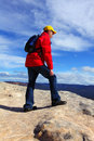 Mountain hiker top of mountain a hike touristr or bushwalker admiring views Stock Photography