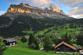 Mountain and houses in switzerland Stock Photo