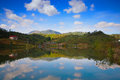 Mountain lake with reflect clouds Stock Image