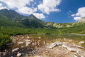 Mountain lake and rocky ridge under the blue sky high tatras slovakia europe Stock Images