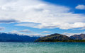 Mountain lake under blue cloudy sky new zealand Royalty Free Stock Images