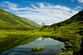 Mountain lake with water reflection. Royalty Free Stock Image