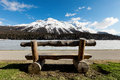 Mountain landscape beautiful lake frozen wooden bench Stock Photo