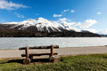 Mountain landscape beautiful lake ice wooden bench Royalty Free Stock Photography