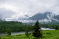 Mountain landscape in the fog and the clouds to the river Royalty Free Stock Photo