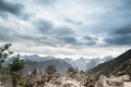 Mountain landscape with grey sky and clouds. Royalty Free Stock Photo