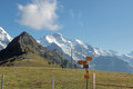 Mountain landscape with hiking route trails signs at high peak Switzerland with signpost Royalty Free Stock Photo