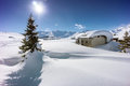 Mountain landscape, hut covered with snow in the mountains Stock Photo