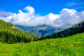 Mountain Landscape With Puffy Clouds Royalty Free Stock Photo