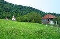 Mountain landscape with white country church, Serbia Royalty Free Stock Photo