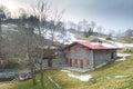 Mountain lodge stone in the winter landscape italian alps Stock Photo