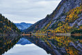 Mountain mirroring in calm waters side with tree vegetation completely seas a lake norway Royalty Free Stock Photos
