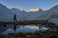 Mountain morning view a man looking at the over snow lake to mount mills in the sierra nevada mountains Royalty Free Stock Images