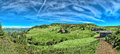 Mountain panorama italian in south tyrol with chalet dairy cows and green pastures on a sunny day Royalty Free Stock Photo