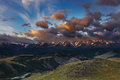 Mountain panorama landscape with river and snowy peaks at sunrise Stock Images