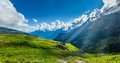 Mountain panorama peaceful alpine meadow in himalayas with sun rays Royalty Free Stock Image