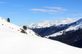 Mountain panorama with snow, trees and blue sky in winter in Stubai Alps Royalty Free Stock Photo