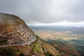 Mountain pass with a road and a car foggy climbing Stock Images